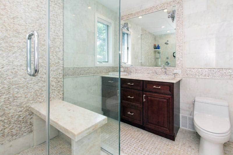 Shower with quartz bench and basketweave tile