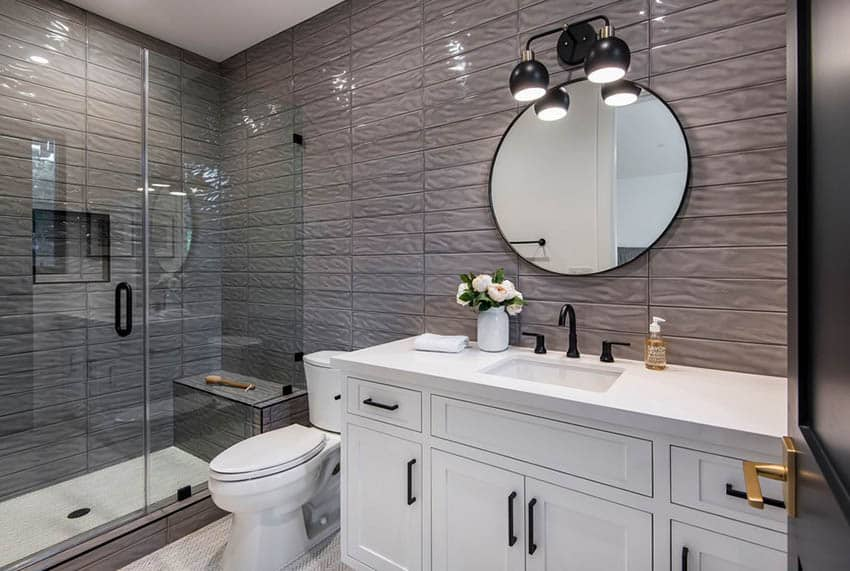Small shower with bench and textured wall tile