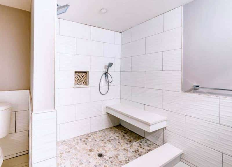 Tile walk in shower with floating bench