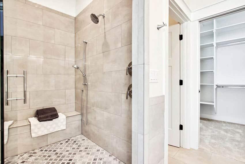 Walk in porcelain tile shower with bench