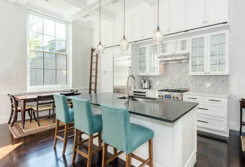 White kitchen with black countertop island