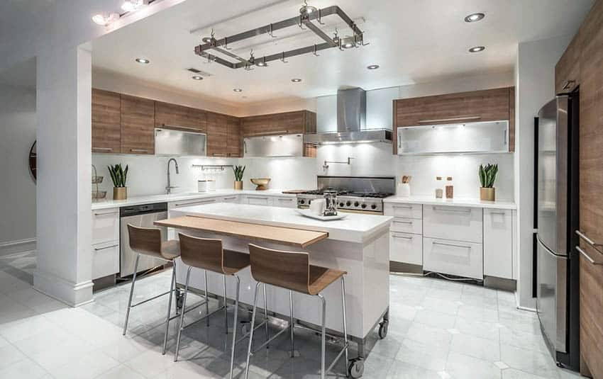 Contemporary kitchen with marble tile flooring and white movable island