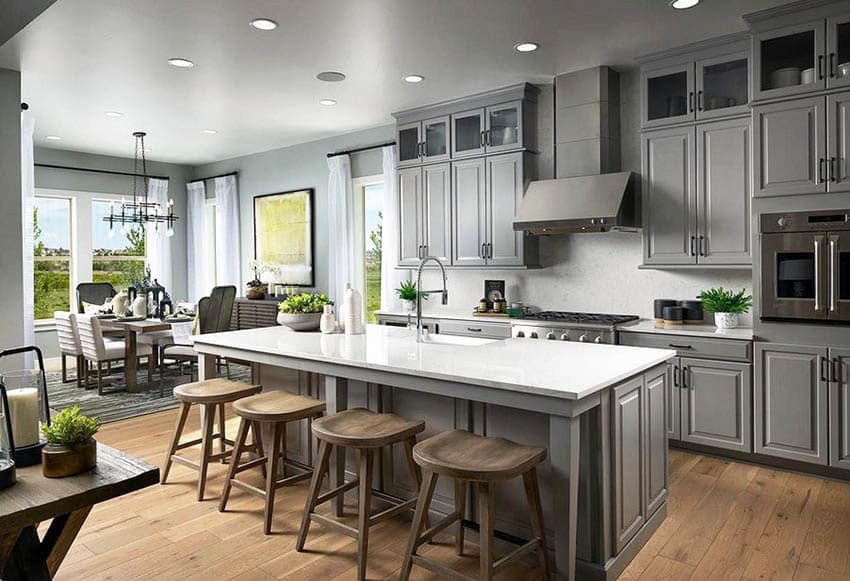 Kitchen with gray cabinets, engineered hardwood flooring and white quartz countertops