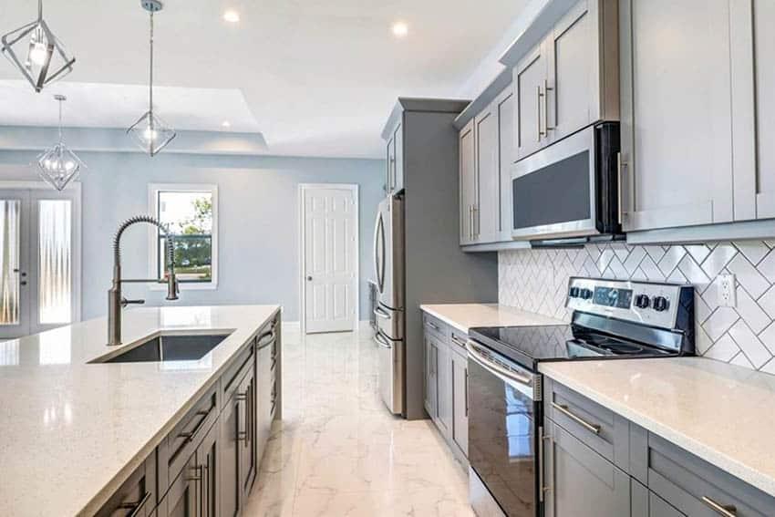 Kitchen with porcelain tile flooring gray cabinets quartz countertop