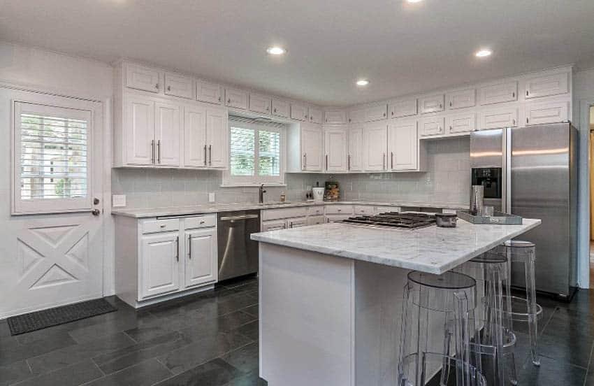 White kitchen with black slate tile flooring