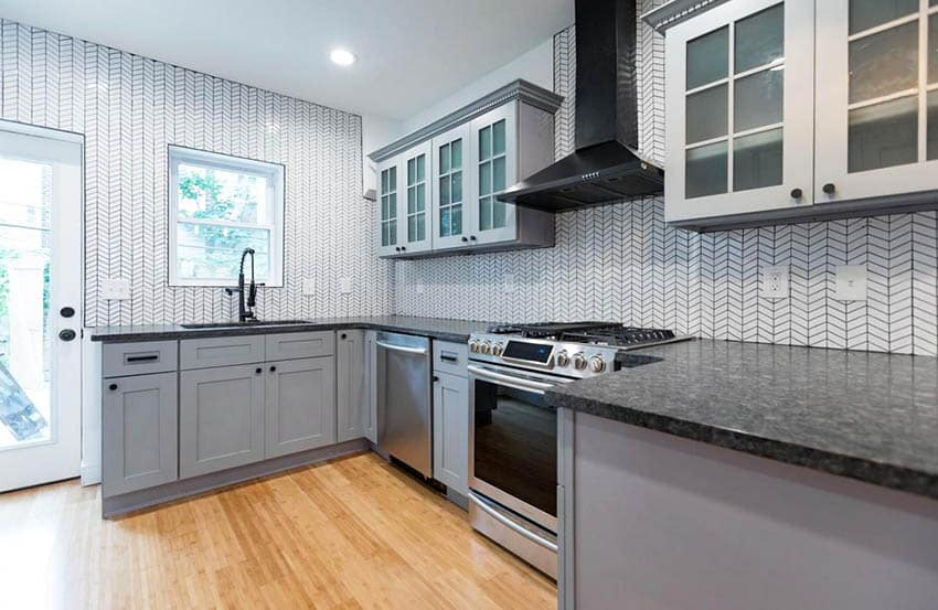 Kitchen with diagonal subway tile backsplash and gray cabinets