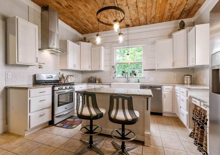 Kitchen with mini subway tile white cabinets and shiplap walls