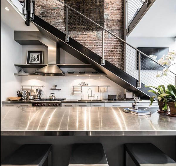 Loft apartment kitchen with stainless steel countertops