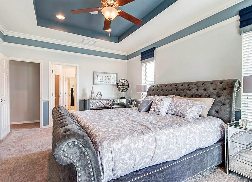 Bedroom with blue painted tray ceiling and white border