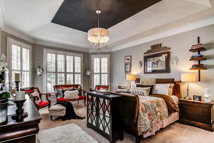 Bedroom with painted black tray ceiling
