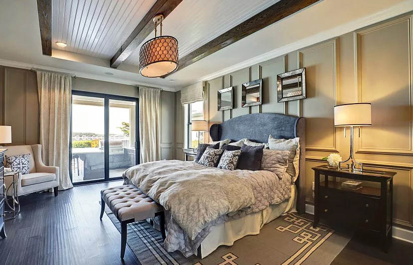 Bedroom with tray ceiling with shiplap and wood beams