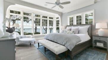 Contemporary master bedroom with hardwood look laminate flooring
