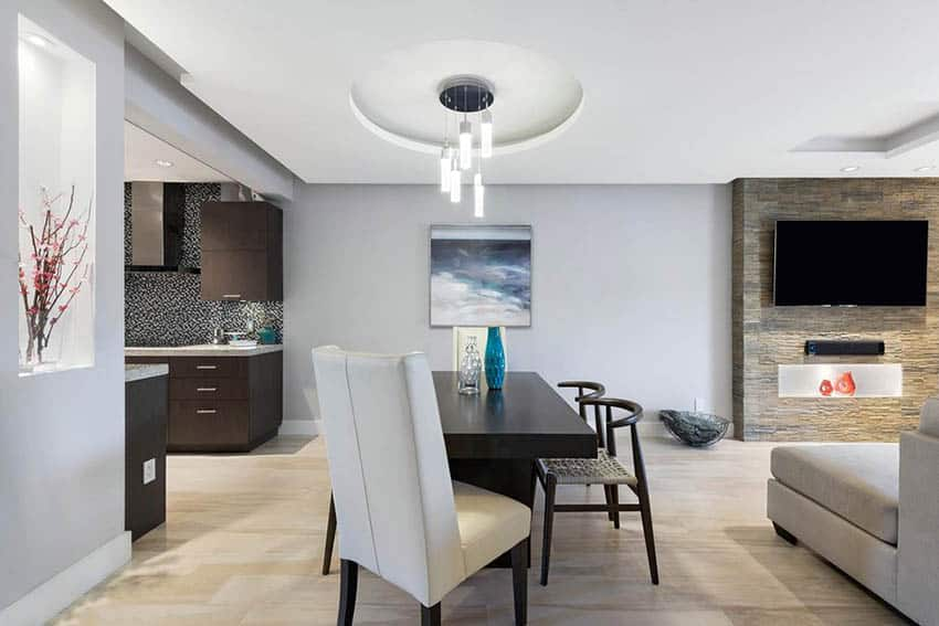 Dining room with circular tray ceiling pendant lighting