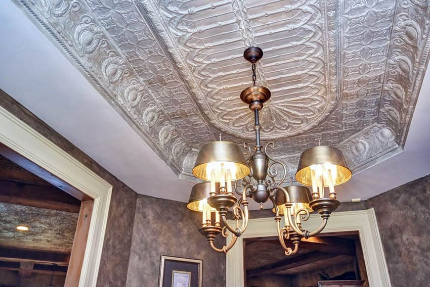 Dining room with tin tray ceiling and chandelier
