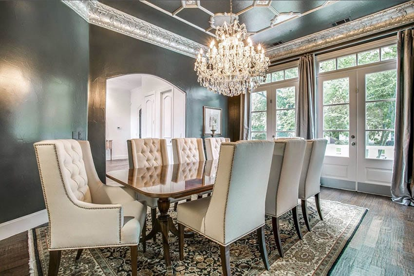 Formal dining room with black walls decorative tin tray ceiling with chandelier