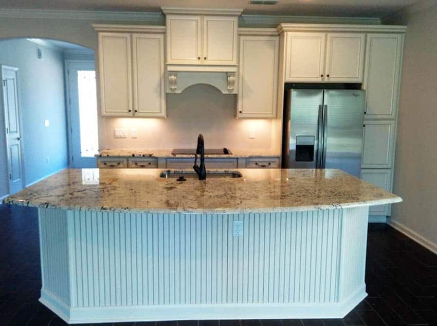 Kitchen with cream cabinets and large beadboard island