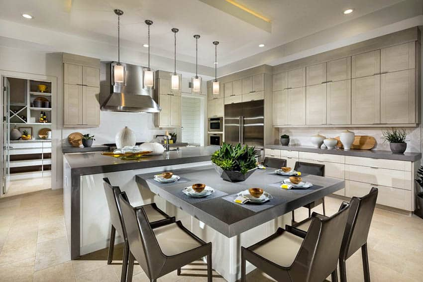 Kitchen with reverse tray ceiling over island with pendant lights and open concept