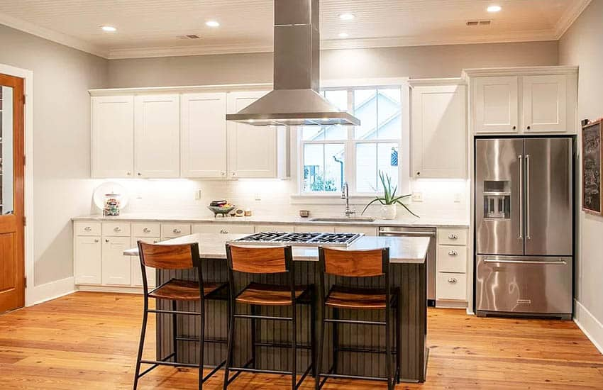 Kitchen with white cabinets and gray beadboard island