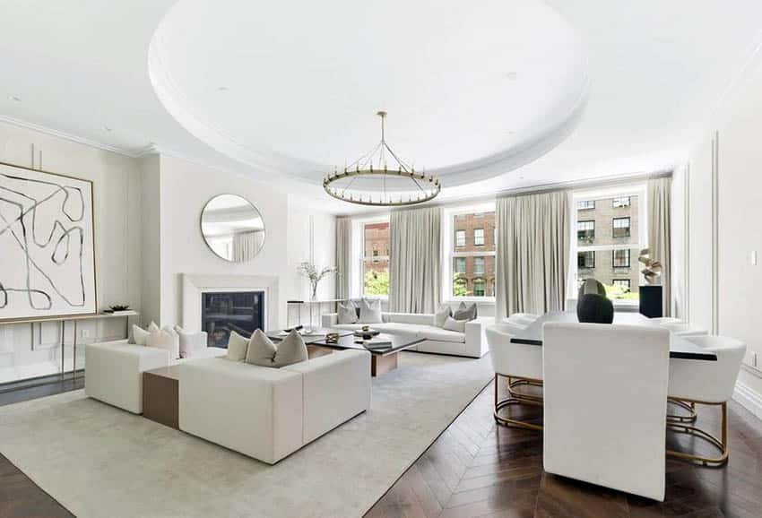 Living room with round tray ceiling and circular chandelier