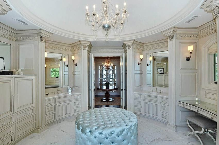 Master bathroom with circular tray ceiling chandelier and cream vanities