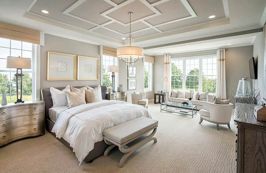 Master bedroom with geometric design tray ceiling with drum chandelier