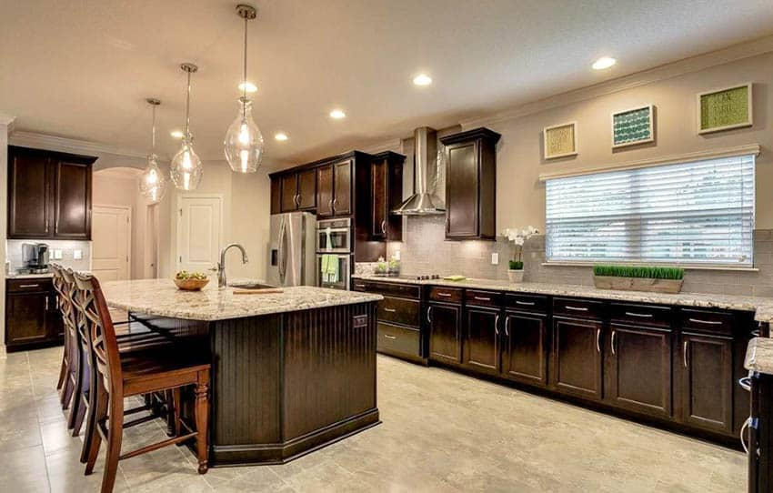 Open concept kitchen with dark wood cabinets beadboard side island