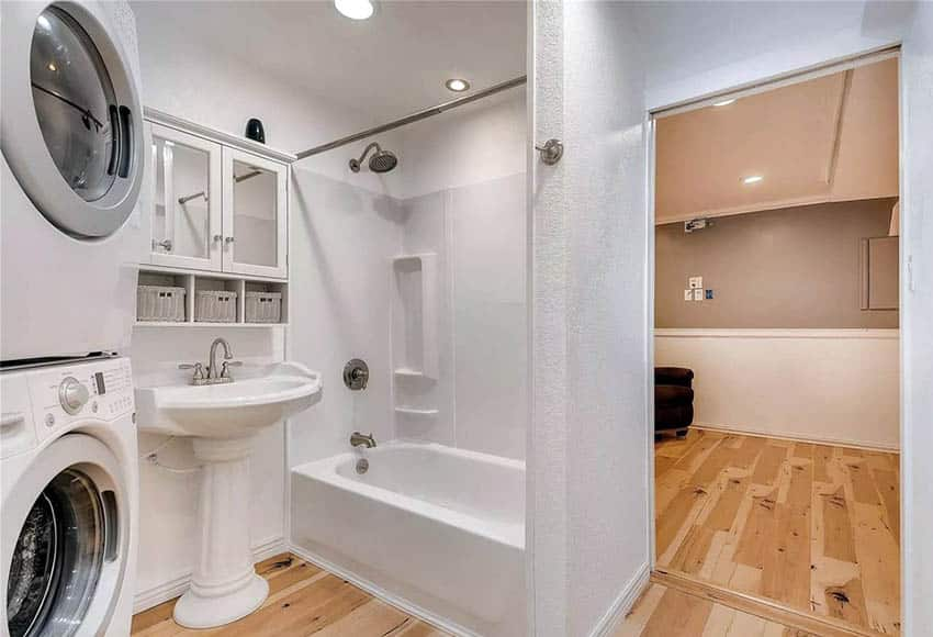 Basement bathroom with laundry washer and dryer
