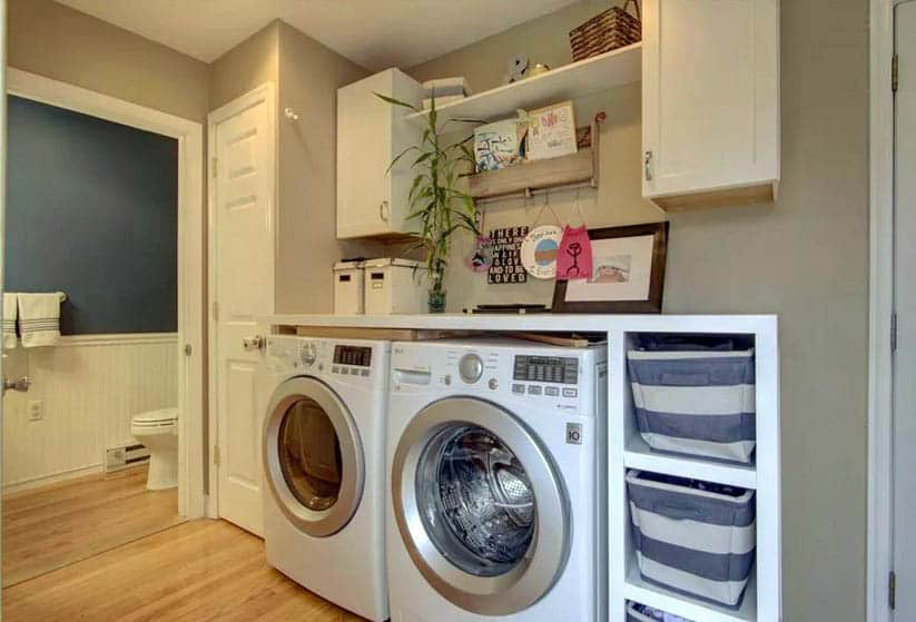 Basement laundry with organization storage and small bathroom