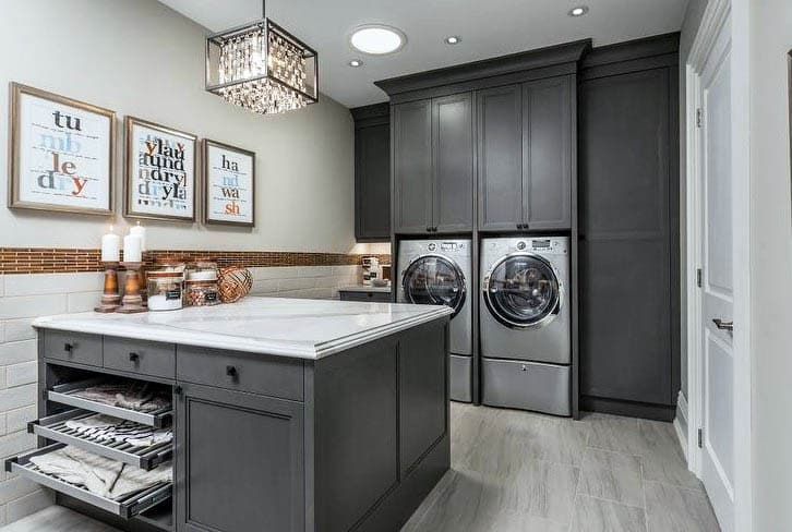 Basement laundry with peninsula island built in storage