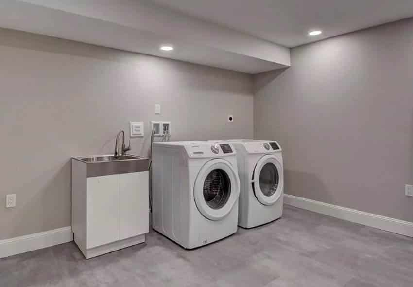 Basement laundry with small sink