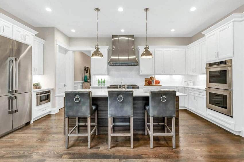Beautiful white cabinet kitchen with hidden hinges and wood plank island