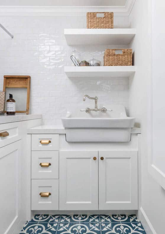 Farmhouse style laundry room with white subway tile and open shelving
