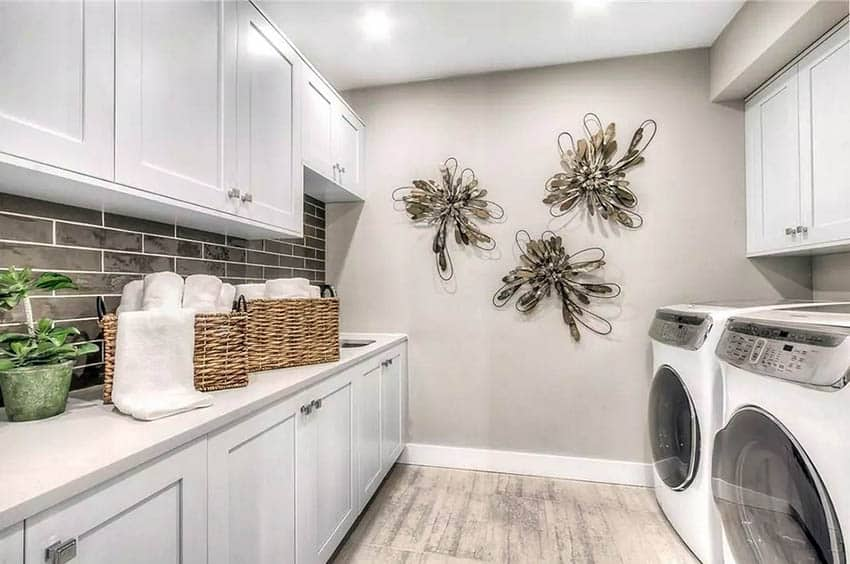 Finished basement laundry room with white cabinets wood look tile floor
