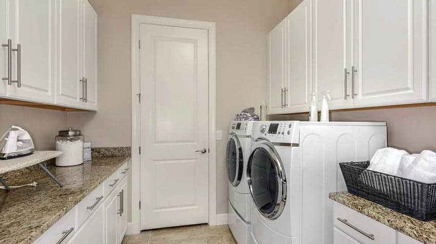Finished laundry room with white cabinets granite countertops