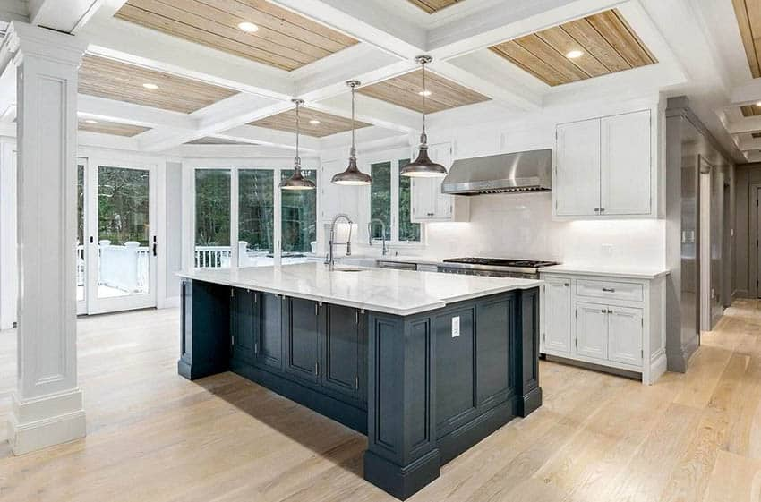 Kitchen with tongue and groove wood flooring and coffered ceiling with white cabinets and marble countertops