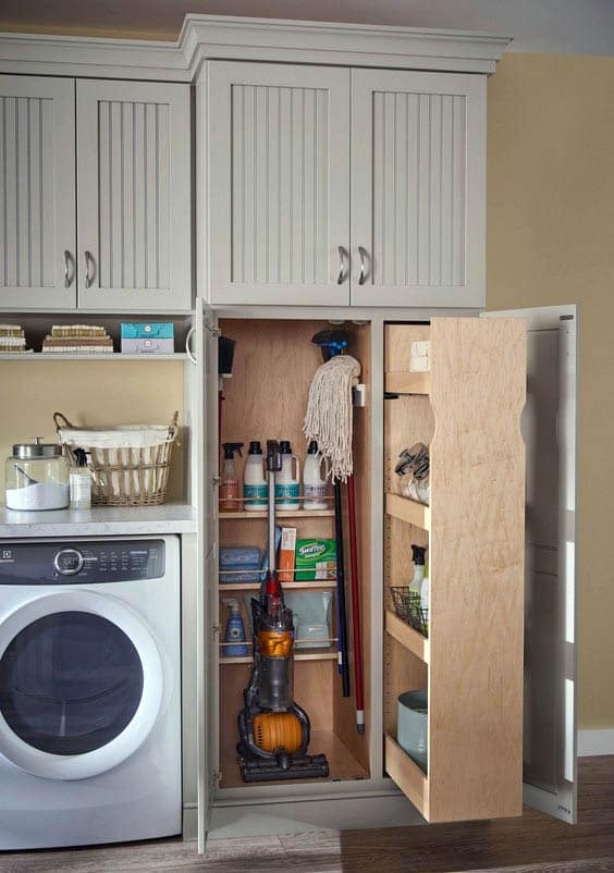 Laundry with built in storage with pull out shelving