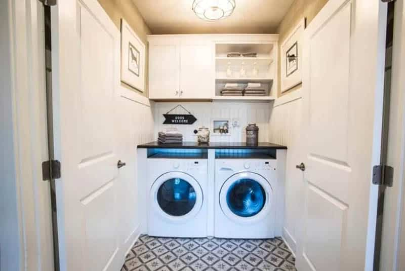 Laundry room with bead board walls white cabinets