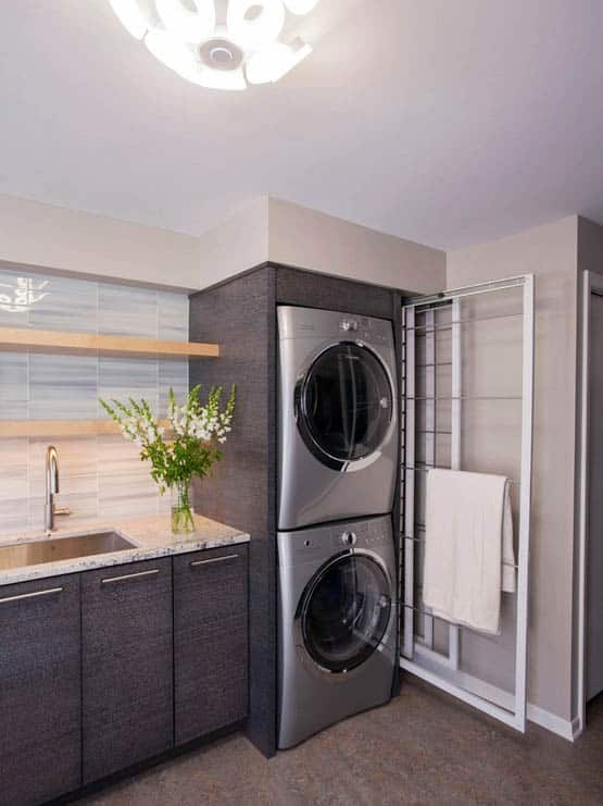 Laundry room with custom washer dryer built in and towel rack