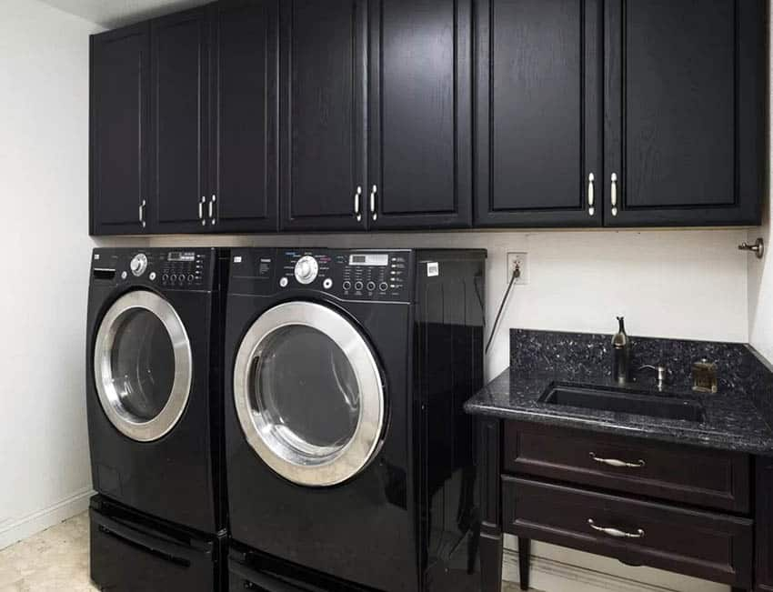 Laundry room with front load washer dryer black cabinets sink vanity