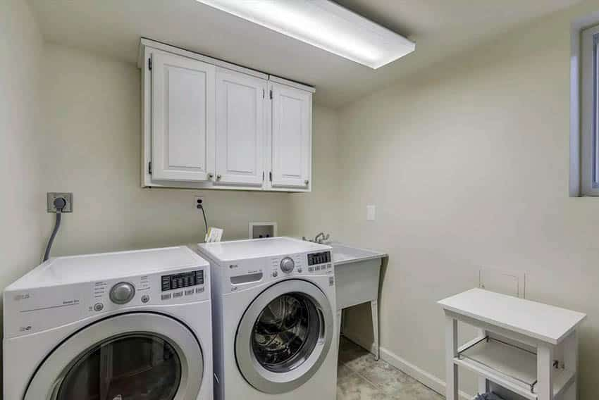 Laundry room with large panel lighting