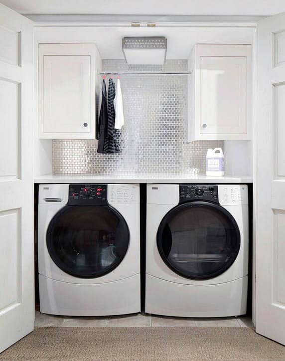 Laundry room with metallic mini brick wall backsplash