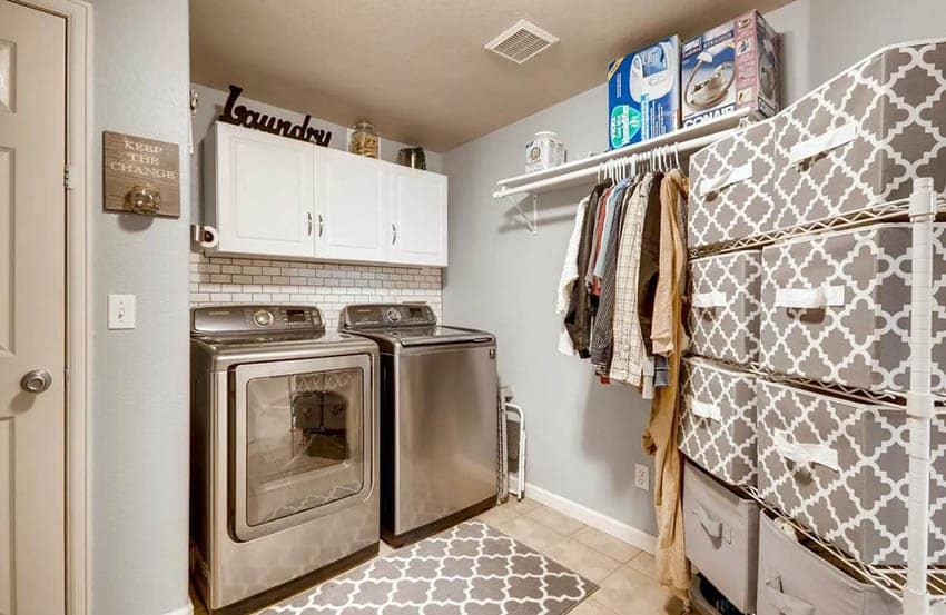 Laundry room with storage bins and wall cabinets