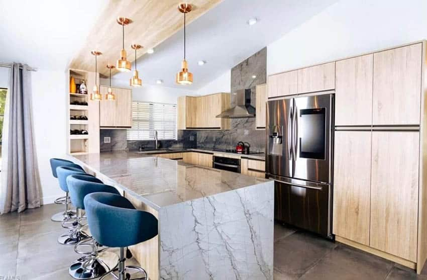 Modern kitchen with invisible cabinet door hinges, European style cabinets and quartz countertops
