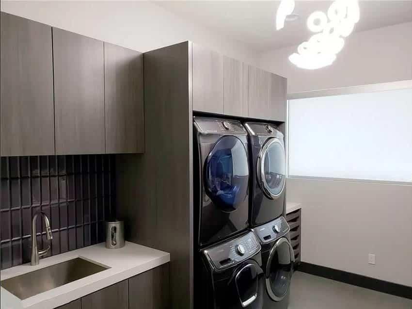 Modern laundry room with washer dryer enclosure counter sink tile backsplash