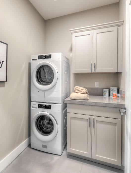 Small laundry room with cabinet storage