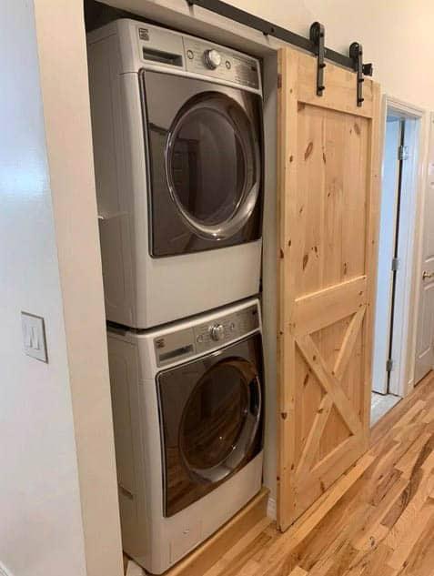 Washer dryer behind sliding barn door