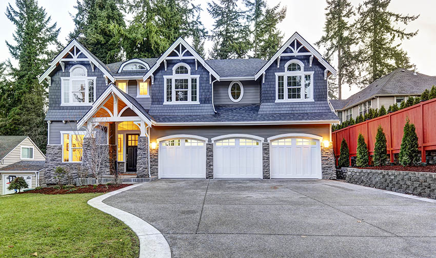 3 car garage with white doors and windows