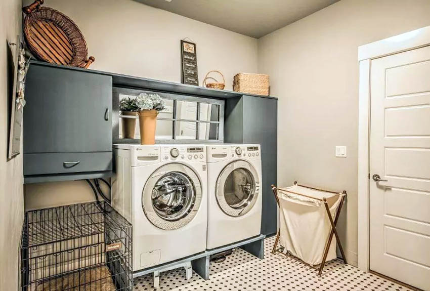 Basement laundry room with wrap around storage cabinets