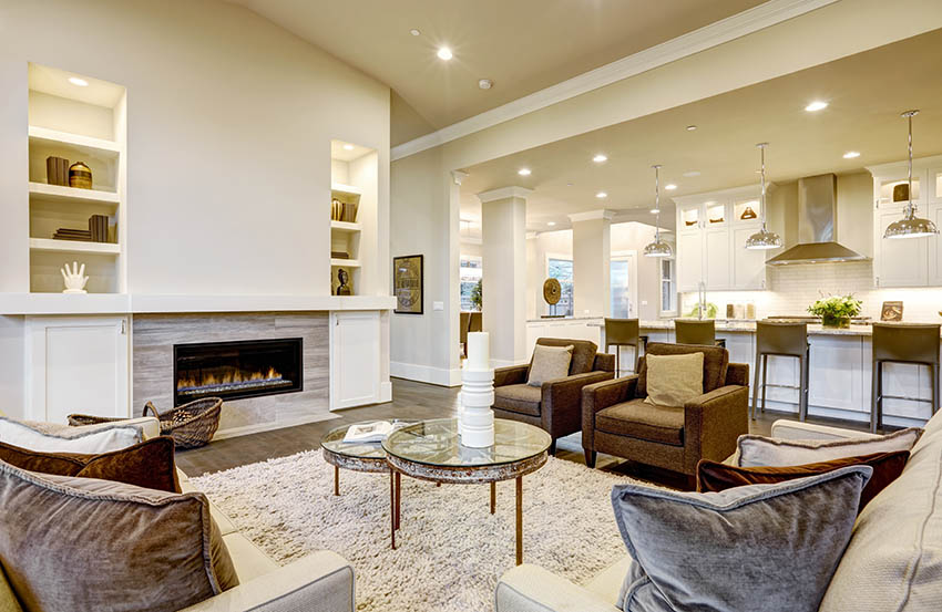 Living room with wall niches lighted by recessed lights