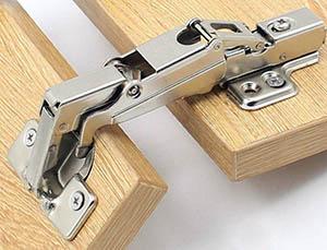 Adjustable cabinet hinge with concealed soft closing mechanism